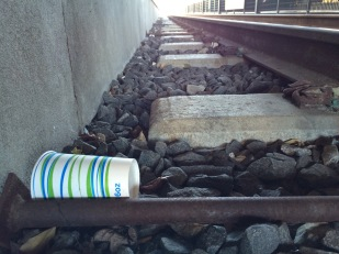 Recycling bins are only a few short feet away along the Light Rail tracks in Uptown.